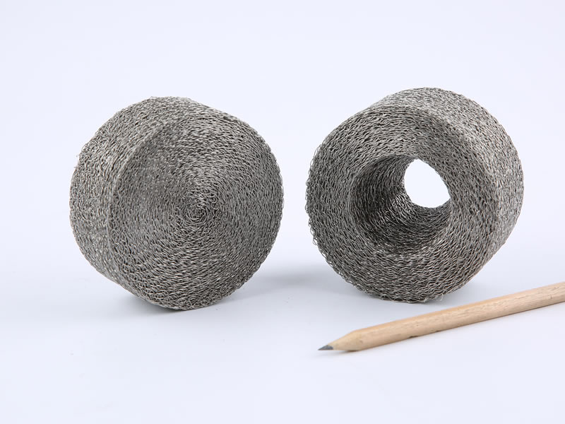 A compressed knitted mesh hollow cylinder and the other with bottom.