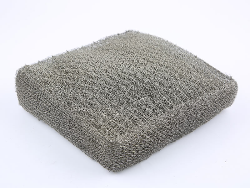 A square shape ginning knitted mesh filter with wrapped edge on the white background.