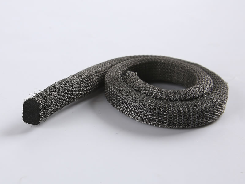 A knitted mesh gasket with rectangular foam on the gray background.