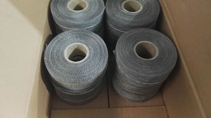Eight rolls of stainless steel knitted mesh with paper pores are put into a carton case.