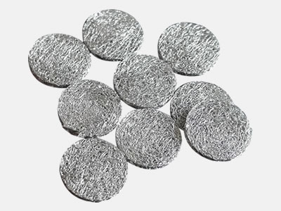 Stainless steel compressed knitted mesh filter discs
