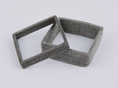 Two different sizes of knitted mesh gaskets on the gray background.
