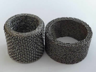 Two compressed knitted mesh and one is combined with woven wire mesh.