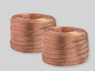 Several rolls of copper knitted shielding meshes on the white background.