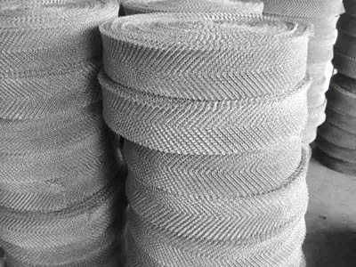 Several rolls of ginning knitted mesh with herringbone shapes.