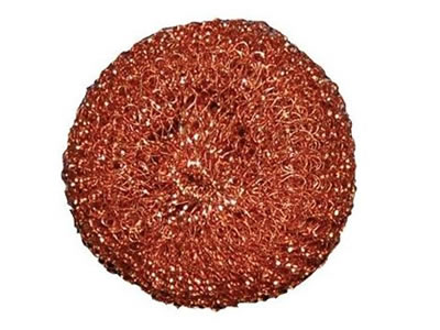 A copper knitted cleaning ball on the white background.