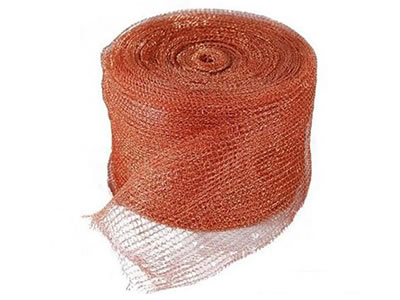A roll of copper knitted wire mesh on the white background.