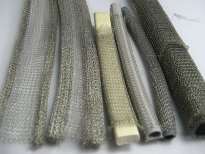 Several different types of knitted mesh gasket on the gray background.
