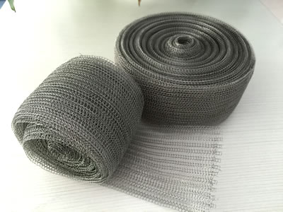 Two rolls of knitted wire mesh tape on the table.