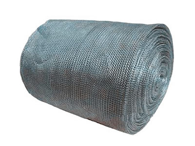 A roll of galvanized knitted wire mesh on the white background.