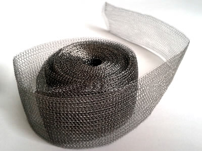 A roll of flatten knitted wire mesh tape on the white background.